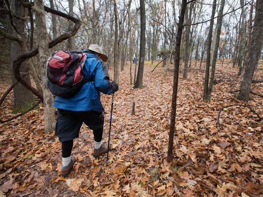 Robert Crampton walks down the trail at Lake Springfield on Monday, Nov. 28, 2016. Crampton is planning on hiking the Appalachian Trail with a group of veterans in 2018.