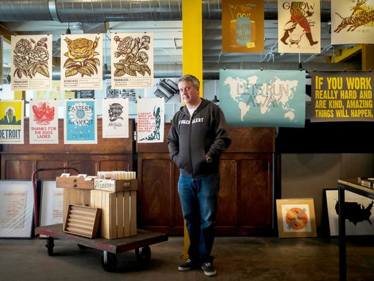 Toby Barlow poses for at Signal Return Letterpress in Detroit in July 2013. He is a co-founder of the business in Eastern Market.