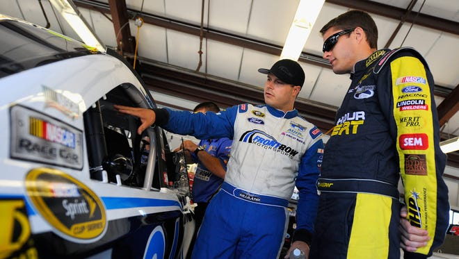 David Ragan, right, and teammate David Gilliland have both re-signed with Front Row Motorsports for 2014.