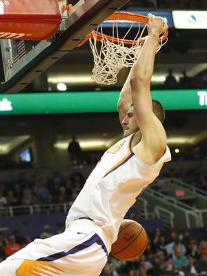 Phoenix Suns center Alex Len (21) slams two against the Atlanta Hawks during the third quarter at Talking Stick Resort Arena in Phoenix January 2, 2018.