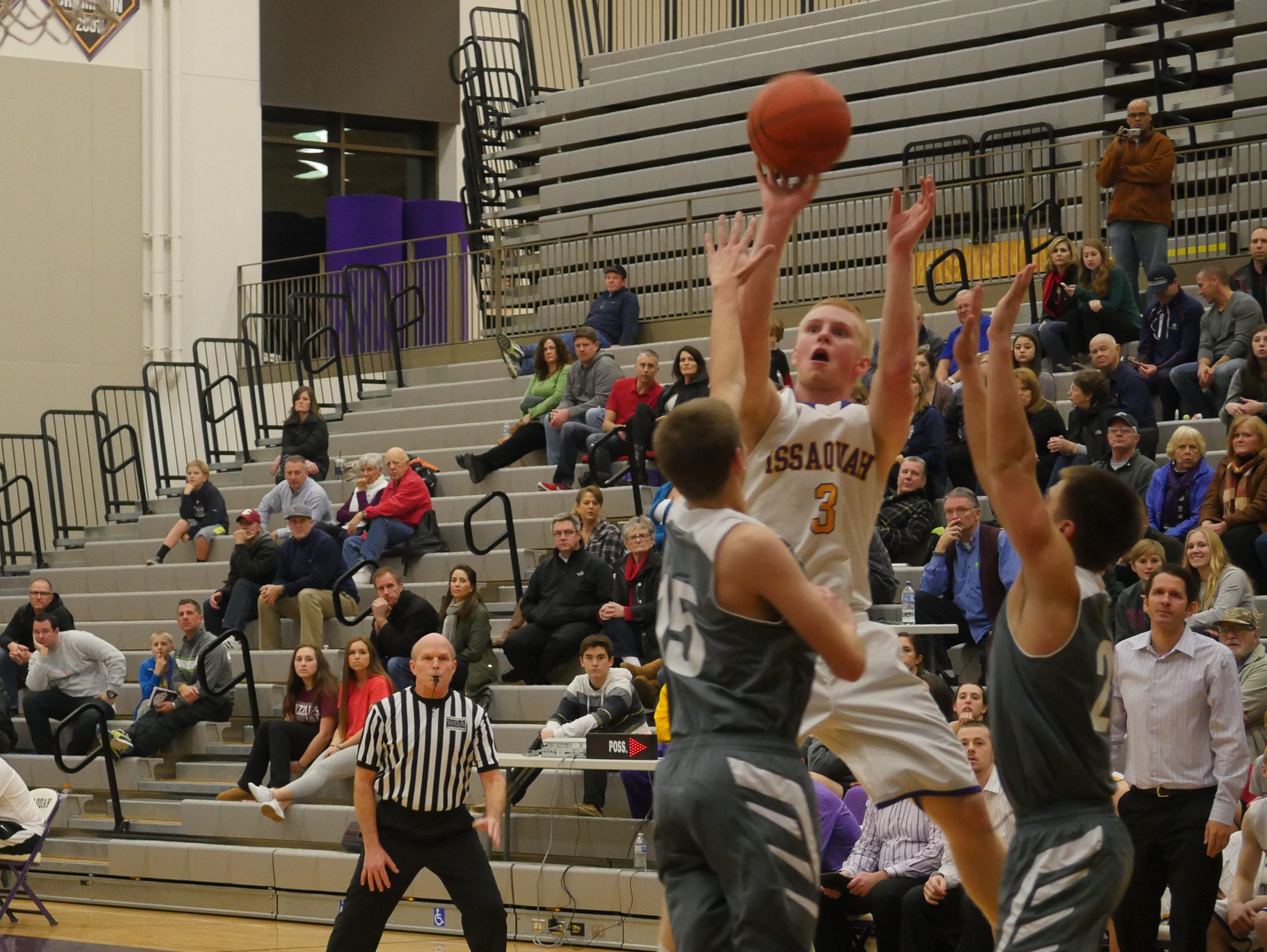 Issaquah guard Ty Gibson takes a shot.