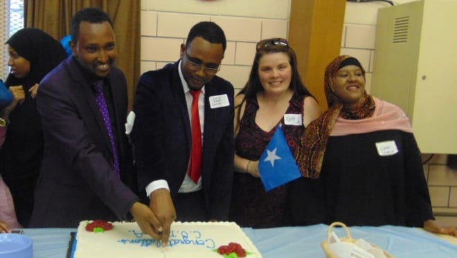The Community Services Agency Inc. held its grand opening earlier this month at Trinity Lutheran Church in Green Bay. Pictured are Mahamed Rage Mahamed, COMSA vice president; Said Hassan, COMSA president; Katherine Stockman, COMSA secretary; and Luul Abdi, Mahamed's wife.