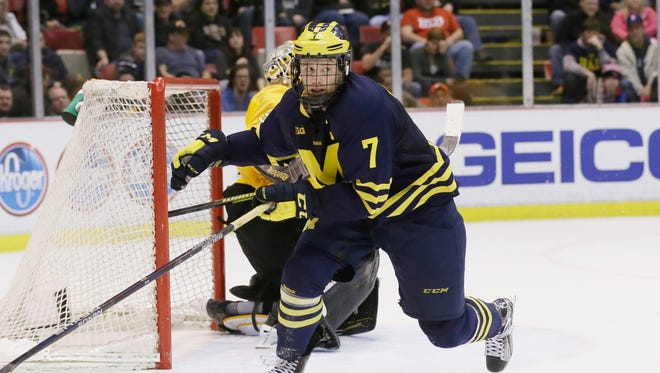 Michigan forward JT Compher.