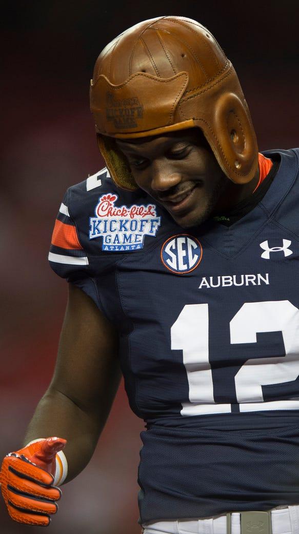 Auburn wide receiver Jonathan Wallace (12) wears the