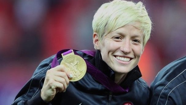 Redding native Megan Rapinoe holds the gold medal she won with the U.S. Women's National Team at the London Olympics in 2012.