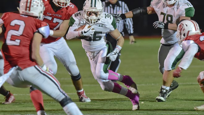 """Geoffrey Jamiel of D-Y attempts to break between multiple Barnstable defenders in a game last year. The Massachusetts Interscholastic Athletic Association last month announced a """"Fall II"""" season for football, which would begin following the conclusion of the winter season in late February."""