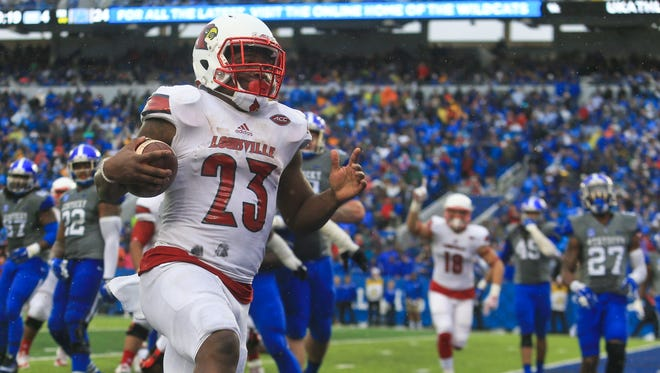 Louisville's Brandon Radcliff scores the go-ahead touchdown to put the Cardinals up over Kentucky in the fourth quarter.