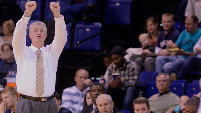 Buzz Peterson, shown while coaching at UNC Wilmington, has been promoted to assistant general manager by the Charlotte Hornets.