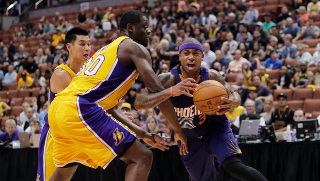 The Phoenix Suns' Isaiah Thomas (right) is pressured by the Los Angeles Lakers' Julius Randle (center) and Jeremy Lin during the second half of a preseason game Tuesday in Anaheim. The Suns won 114-108 in overtime.