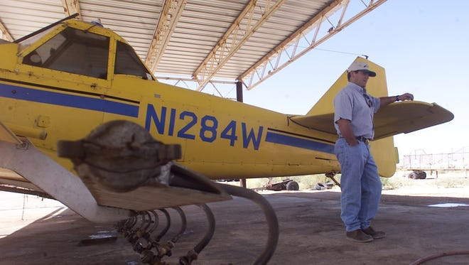 David Armstrong of C&D Aerial Application stands with his 1976 Weatherly 201B cropduster at the Fabens Airport. The county is going to apply for funds to improve the airport.