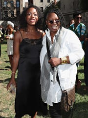 """Whoopi Goldberg (right) catches up with designer Tracy Reese during Reese's New York Fashion Week show on Sept. 11. Goldberg is a producer of """"Strut,"""" a new cable show that looks at the lives and careers of transgender models."""