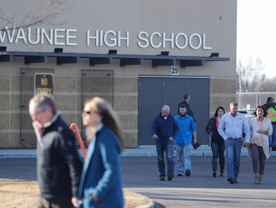 People arrive Friday afternoon at Kewaunee High School