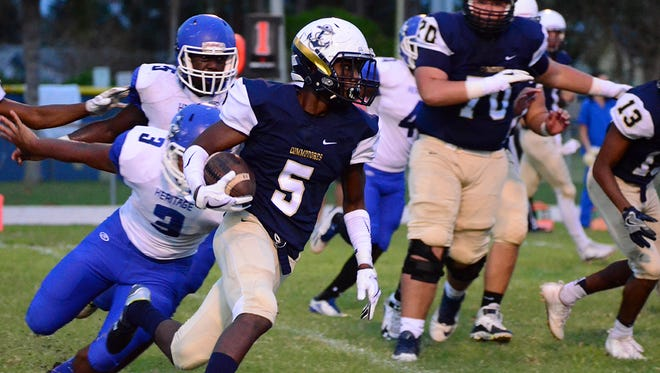 Jarrad Baker carries the ball for Eau Gallie Friday night against Heritage.