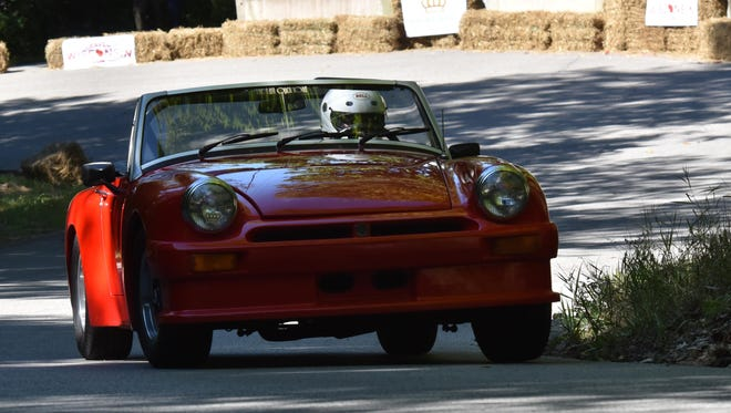 Vic Soderstrom of Oconomowoc swings his 1960 MGA into a tight turn on Norway Street during the Kort Bakkelop at last year's Ephraim Hill Climb & Concours d'Elegance.