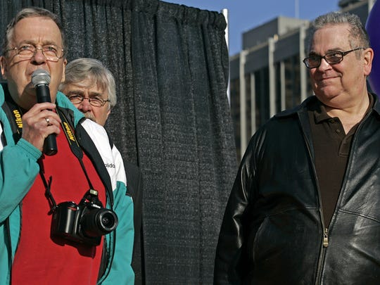 David Twombley, left, addressed the crowd as his partner, Larry Hoch, right, listened as they attended a rally held by One Iowa, the state's largest lesbian, gay, bisexual and transgender advocacy group on Friday, April 3, 2009