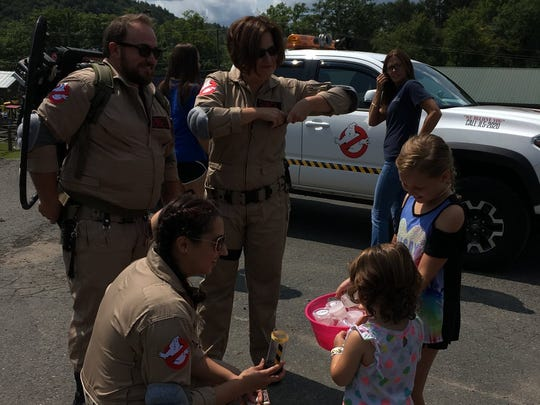 Oana Rosenthal, kneeling, Matthew Bennett and Tara Sobel are shown at a Hudson Valley Ghostbusters event.