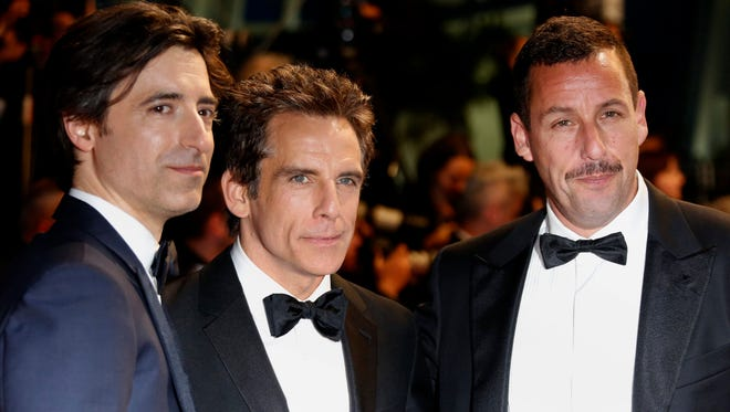 Director Noah Baumbach, left, Ben Stiller and Adam Sandler leave after the premiere of  'The Meyerowitz Stories' during the 70th annual Cannes Film Festival.