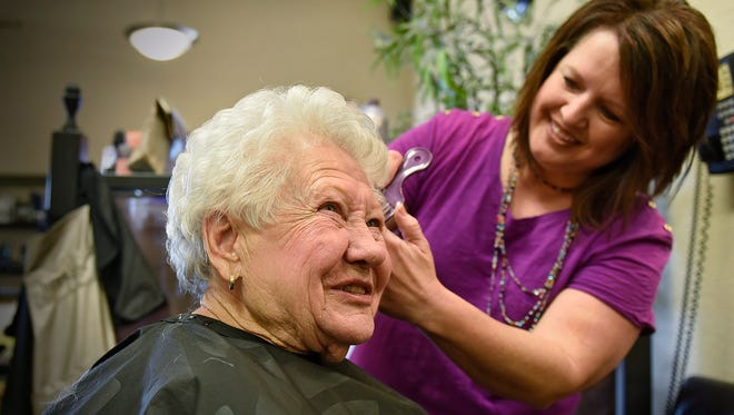 Dee Henning talks about her appreciation for her hairdresser Sandy Hagemeier while getting her hair cut and styled Friday, May 20, at Simple Escape Salon in Sartell. Henning has had a weekly hair appointment for 28 years. When she didn't show up for an appointment in April, concerned staff members at the Salon contacted her family and they found that she had gotten stuck in the bathtub.
