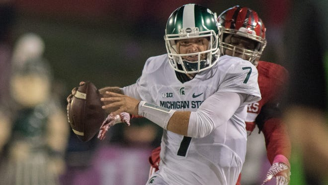 Michigan State quarterback Tyler O'Connor rushes the ball in the second quarter of the loss to Indiana Saturday in Bloomington, Ind.