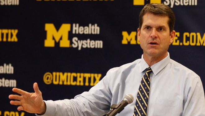 Michigan coach Jim Harbaugh talks about one of his recruited players during press conference on his first recruiting class at Schembechler Hall  on Feb. 4, 2015, in Ann Arbor.