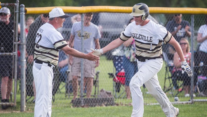 Daleville's Nick Williams hits the game-winning homerun against Wes-Del during their game at Daleville High School Wednesday, May 17, 2017.