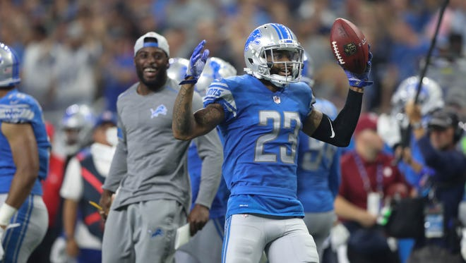 Darius Slay celebrates his interception in the third quarter of the Lions' 30-26 loss to the Falcons, Sunday, Sept. 24, 2017 at Ford Field. Jarrad Davis (in gray) is seen reacting on the sideline.