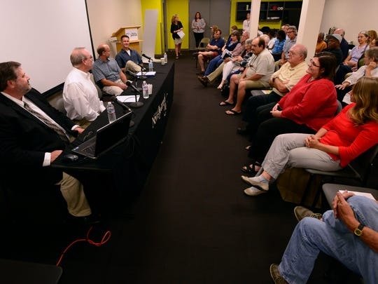 Concerned citizens gather at the Pensacola News Journal on Monday for a forum on the five year anniversary of the Deepwater Horizon oil spill.