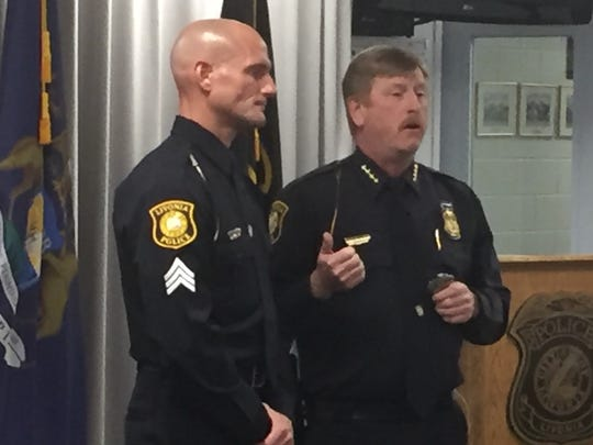 Livonia Chief Curtis Caid, right, introduces newly