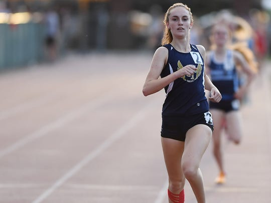 Caroline O'Sullivan, of NV-Old Tappan, finishes first in the 800-meter race at the Bergen County Track Meet of Champions at Hackensack High School on Friday, May 19. 2017.