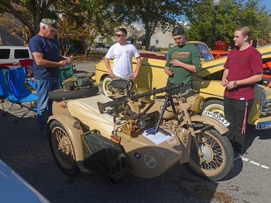Visitors check out a 1941 BMW R71 Saturday during PensaCruise 2015 at Palafox Pier. PensaCruise 2015 features an all-day concert, parade of vehicles, food, bubble soccer and a bounce house.