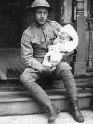 "Harold ""Nick"" Hoy is shown holding his 2-month-old daughter Winifred on Memorial Day 1926. He is wearing his World War I uniform and marched with other veterans in the parade that day. Hoy served as mayor of Spencerport in the 1940s."