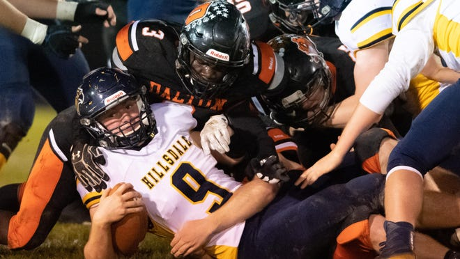Dalton's Adam Knetzer (3) makes sure Hillsdale's Ty Williams (9) is down during the Bulldogs' 34-31 win over the Falcons.