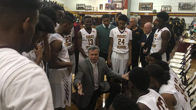 Mount Vernon coach Bob Cimmino talks to his team during its 94-53 defeat of Wadleigh at Mount Vernon High School on Dec. 5, 2015.