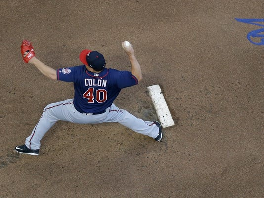 Minnesota Twins starting pitcher Bartolo Colon throws during the first inning of a baseball game Wednesday, Aug. 9, 2017, in Milwaukee. (AP Photo/Morry Gash)