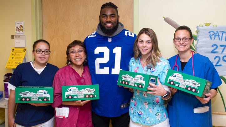 Landon Collins with Arlan Morales, Marie Russo, Ashley