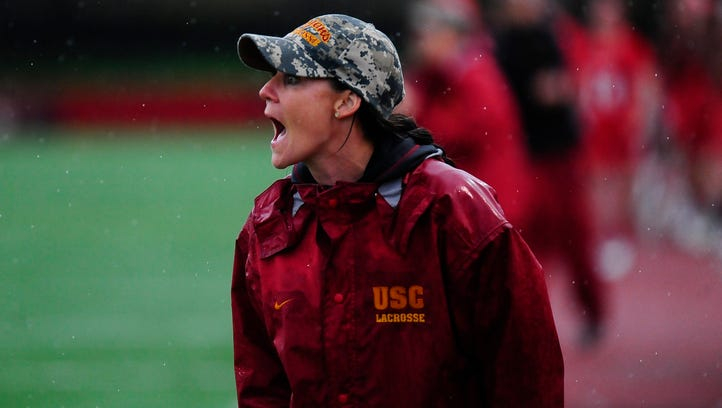 Lindsey Munday of Mountain Lakes gives instructions to the USC women's lacrosse team.