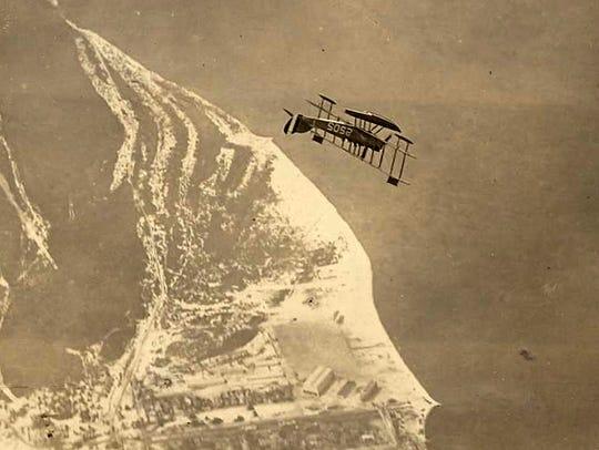 An N-9 seaplane performs a loop over Pensacola Naval