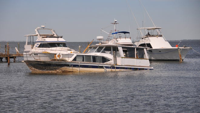 This boat sits offshore in Titusville at the Kenndy Point Yacht Club. Derelict boats still remain in the Indian River Lagoon after Hurricane Irma.