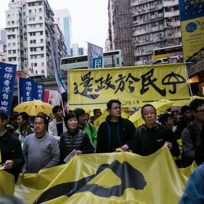 Thousands of pro-democracy activists take part in a democracy march.