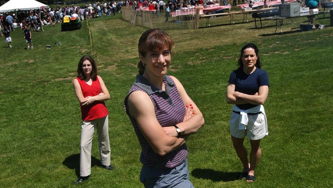 Former Brown University gymnast Amy Cohen, center, is shown attending her 10th reunion in this Journal file photo. Behind her are former teammates Annie Downs, left, and Eileen Rocchio.