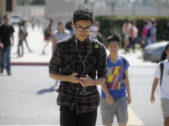 Texting and walking can be dangerous to pedestrians.