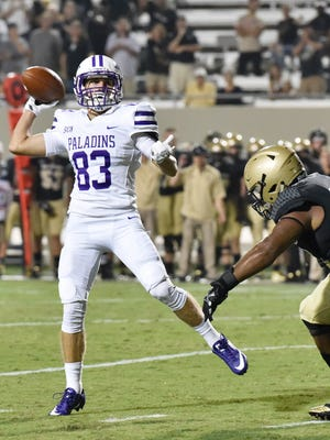 Furman's Ryan DeLuca (83) fires a pass that was intercepted on a two point conversion as the Paladins fell to Wofford 24-23.