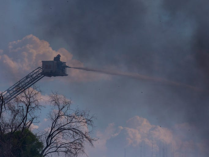 Firefighters respond to a fire at the Arizona Pacific Plastics recycling facility in Phoenix.