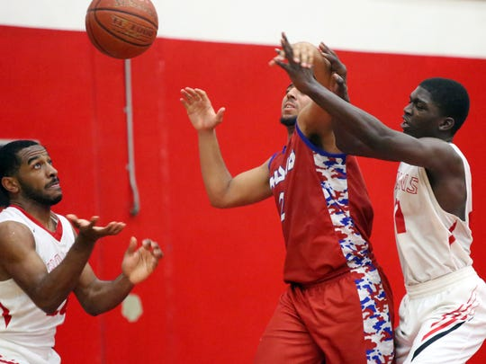 Palm Springs' Damion Lee, left, Indio's Phillip Thigpen, center, and Palm Springs' John Scott battle for a loose ball during the game against Indio in Palm Springs on Friday, February 3, 2017. Palm Springs won 64-61.