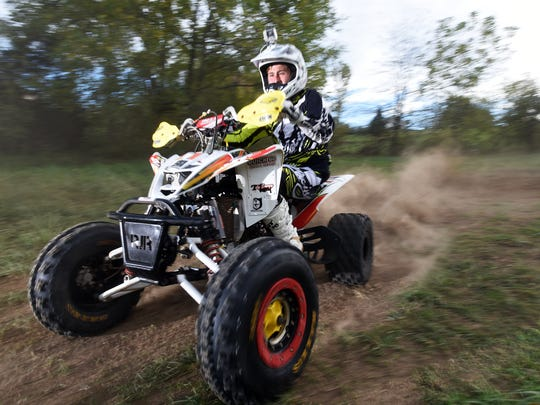 Maysville High School freshman Colton Buck rides his four wheeler at his White Cottage home. Buck is in second place in his class in the Grand National Cross Country series of off-road motorcycle racing.