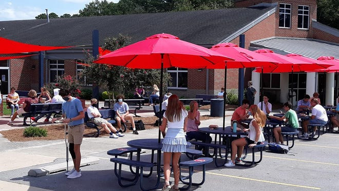 Parrott high school students use new expanded outdoor spaces for lunch.