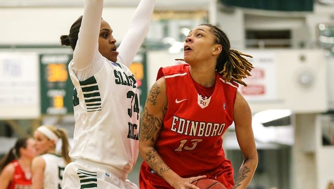 York High graduate Aignee' Freeland, right, is going to play professional women's basketball in Romania.