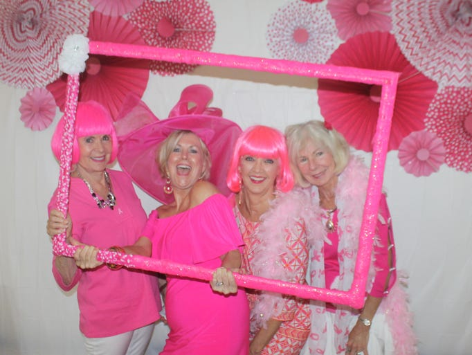 Framed in pink are Pat Matthews, Sharon Cook, Candy