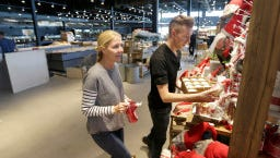 Polly Gabriel, left, a Sendik's home merchandiser, and Bjorn Chinander, a Sendik's home designer work on stocking holiday related items in the Sendik's home department. Preparations were underway to open the new Sendik's Food Market on Miller Park Way, in West Milwaukee on Thursday, November 10, 2016. The store is set to open on November 15. Sendik's plans to open six stores in the next 12 months.