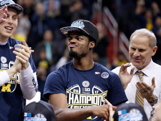 Michigan guard Derrick Walton Jr., center, reacts after being named most outstanding player for the Big Ten tournament, after Michigan defeated Wisconsin 71-56 Sunday, March 12, 2017 in Washington.